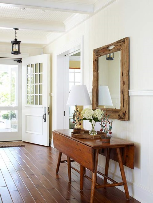table and mirror in entry