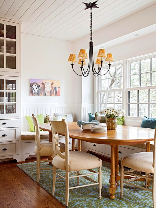 banquette with wood table bhg