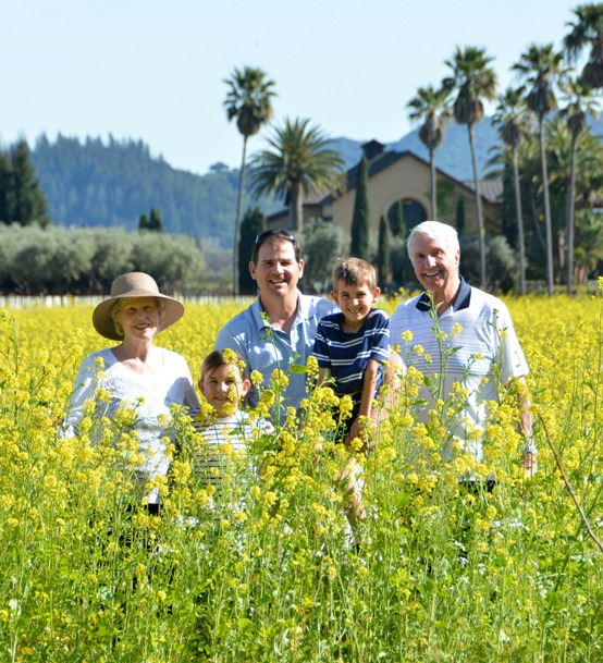 family in mustard flowers