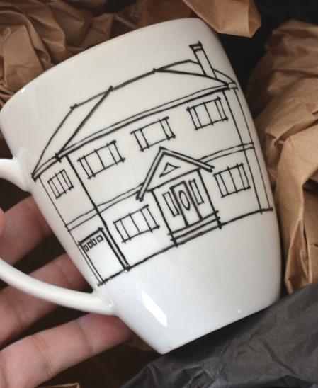 mug with sketch of house