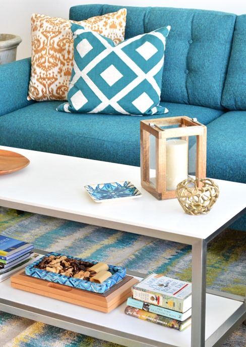 coffee table and teal sofa