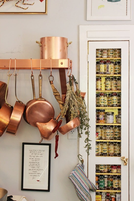 copper pots on rack