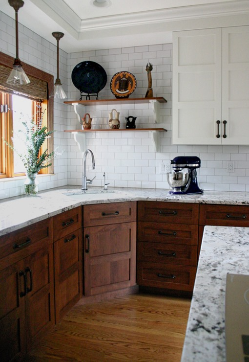 stained wood lower cabinets white uppers