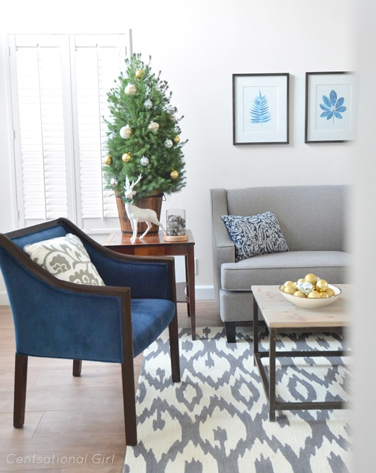 navy chairs gray sofa christmas tree