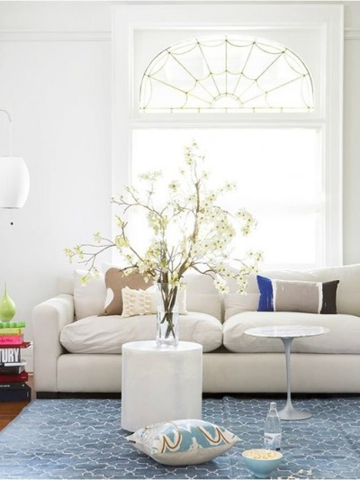 white-sofa-blue-rug-branches.jpg
