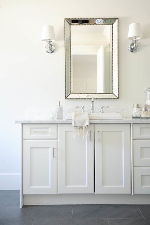 beaded mirror above vanity