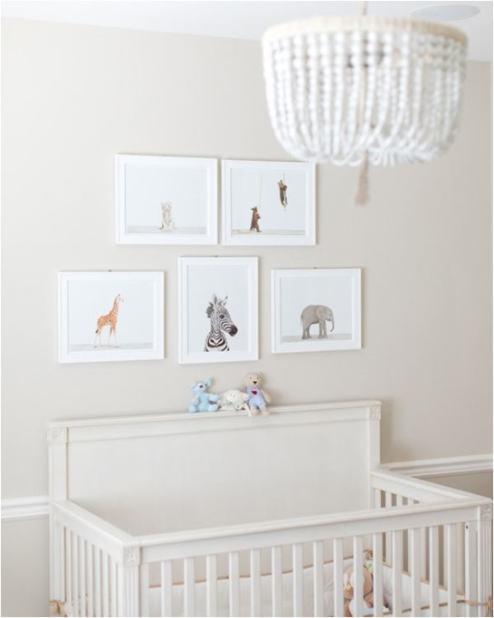 animal prints above crib