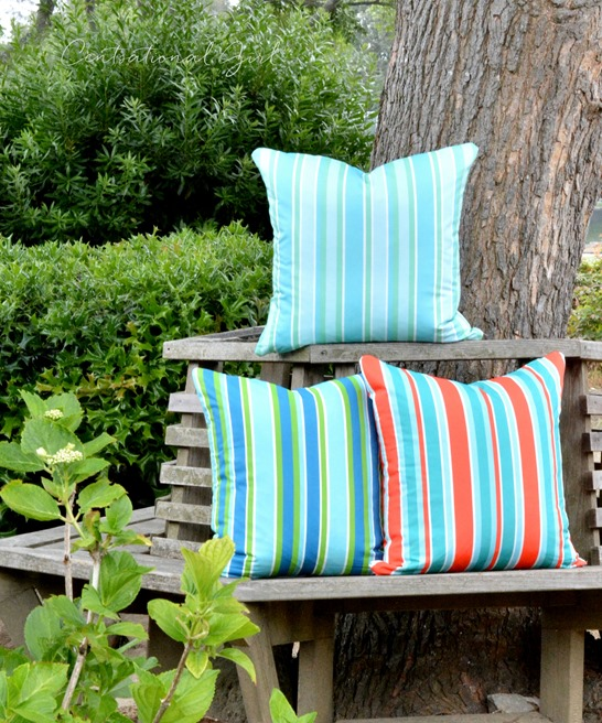 striped pillows tree bench