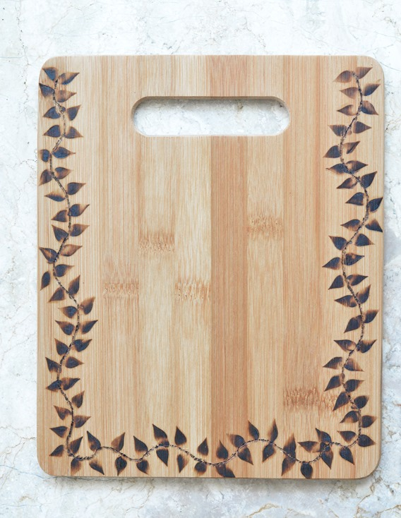 wood burned cutting board with leaf pattern