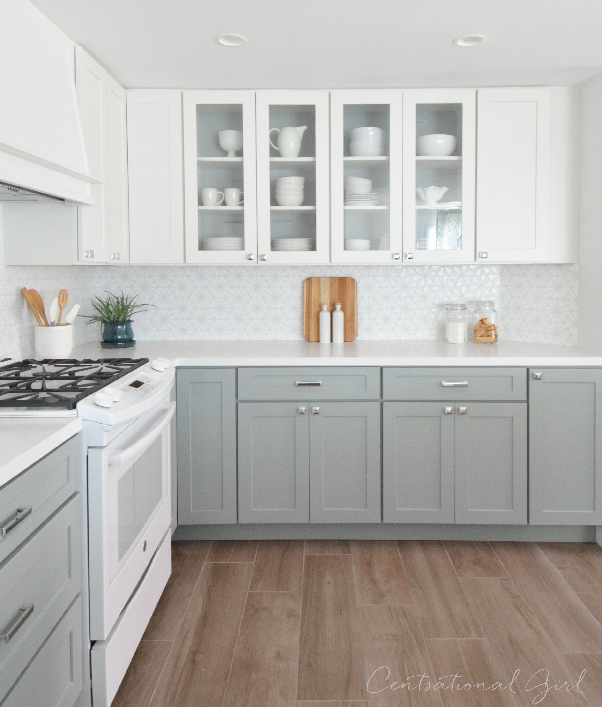 grey kitchen cabinets and white appliances