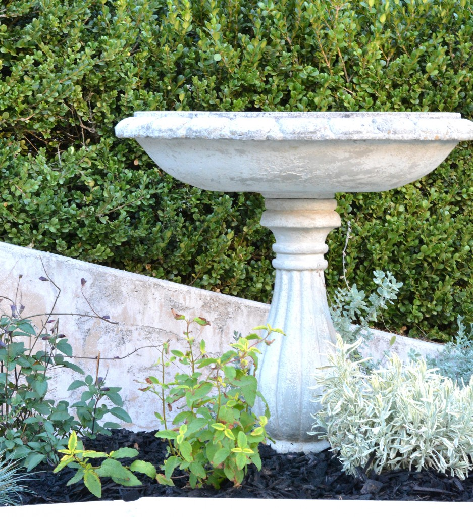 birdbath in planter bed