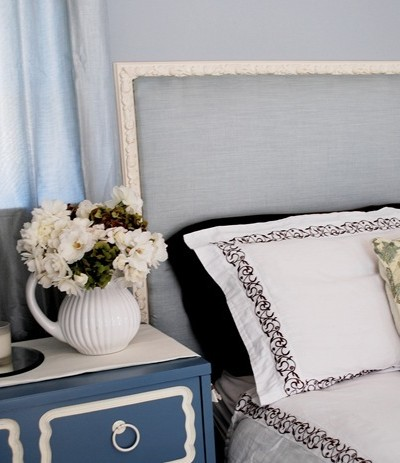 blue fabric covered headboard