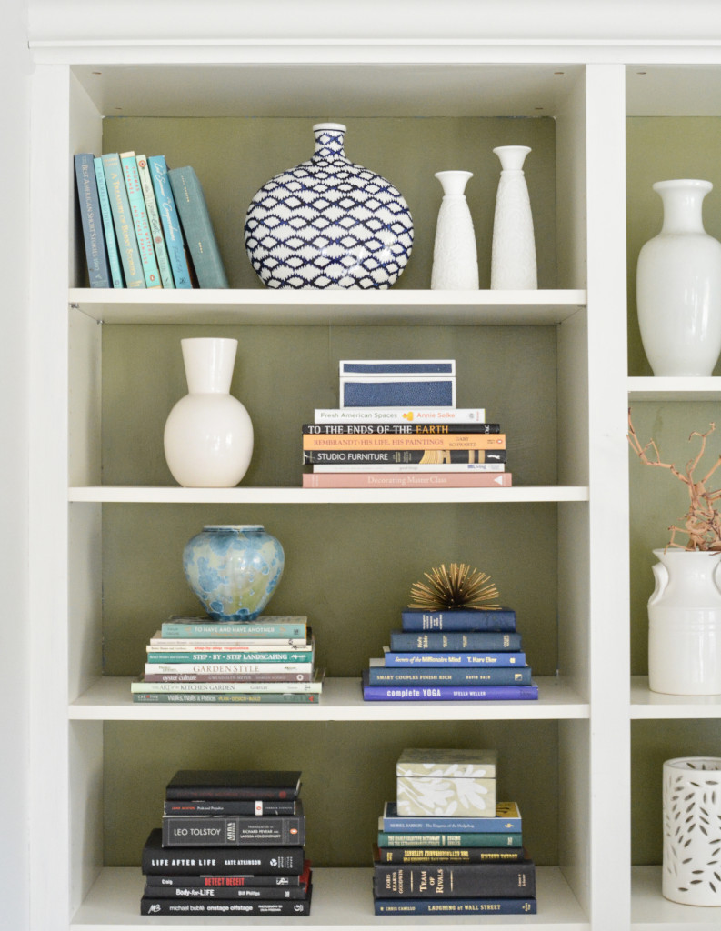 olive green backed bookshelves