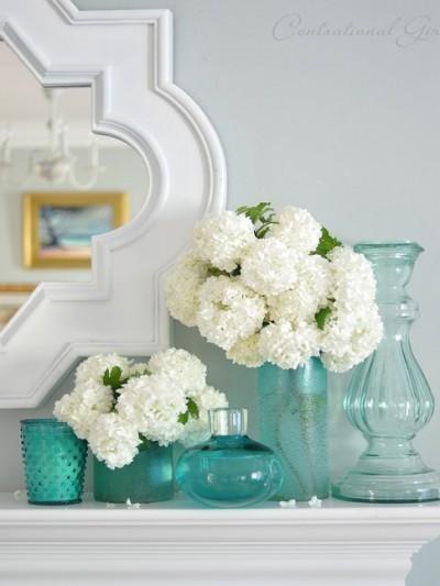 viburnum in blue glass vases
