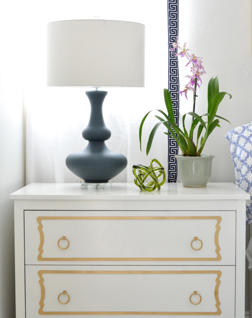 white dresser with overlays navy lamp