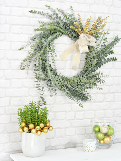 eucalyptus wreath brick wall