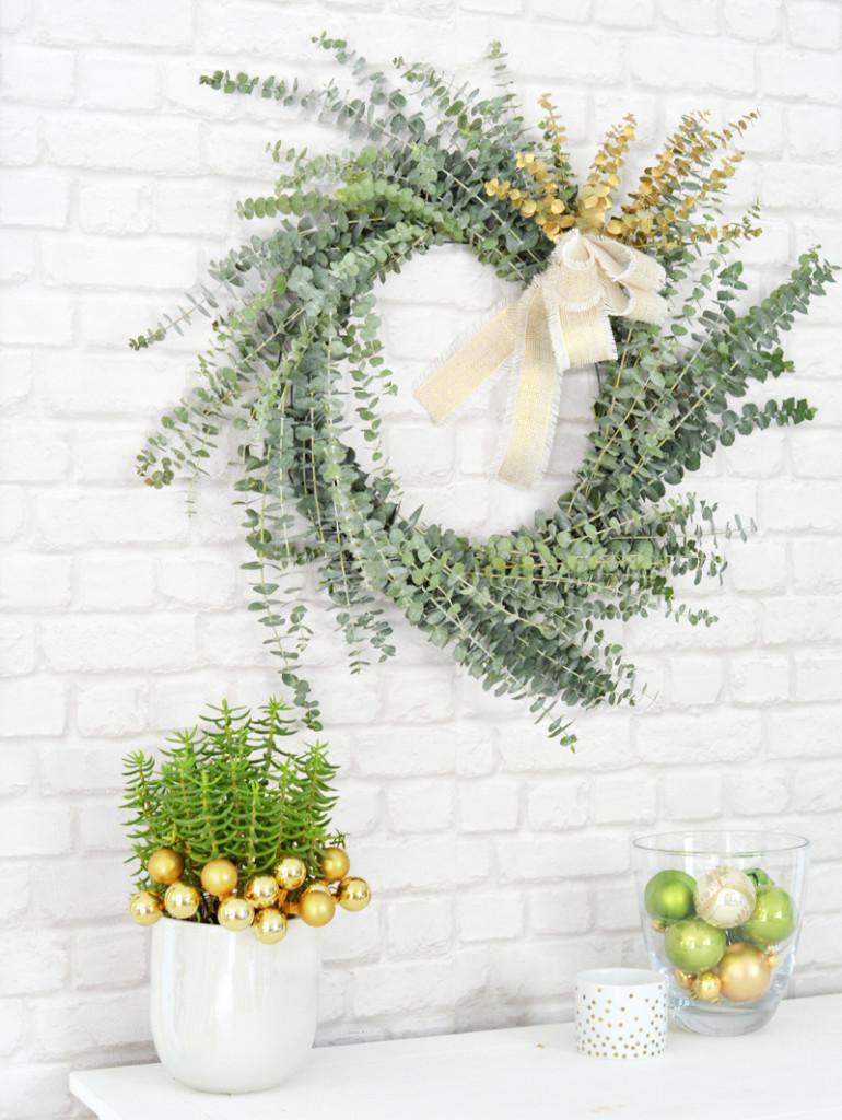 eucalyptus wreath brick wall