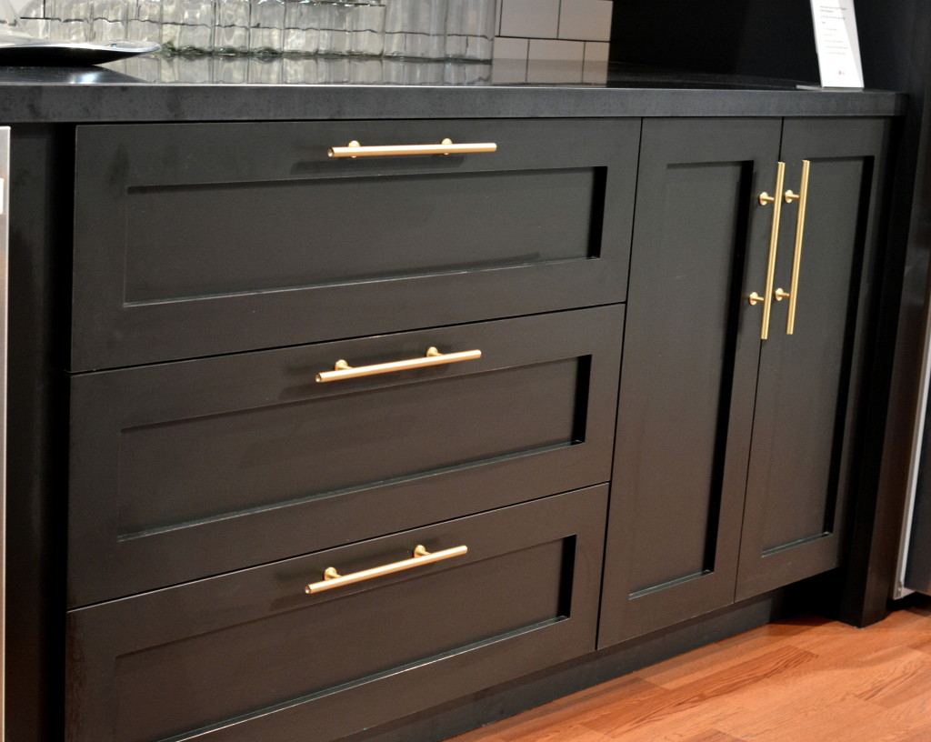 black cabinets brass hardware
