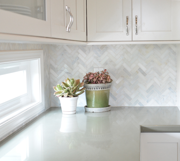 sage quartz countertop herringbone backsplash