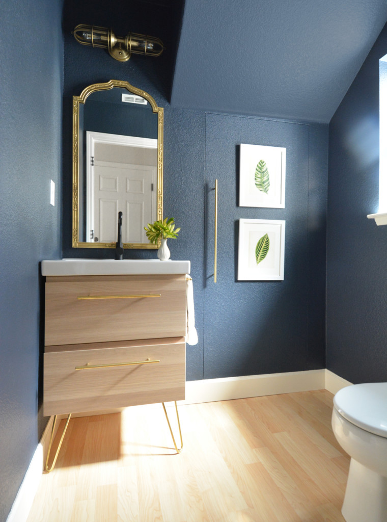 navy walls pale wood vanity