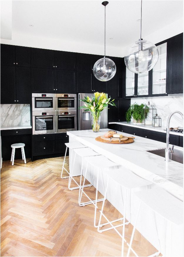 herringbone floors black kitchen cabinets