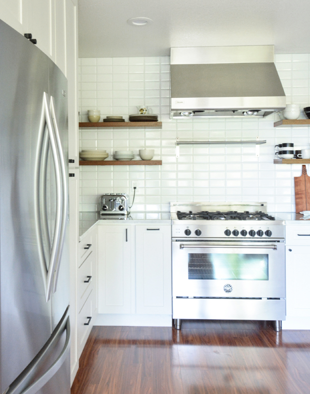 white kitchen remodel beveled tile backsplash