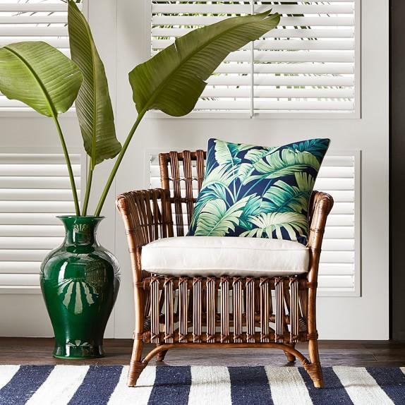 rattan chair tropical pillow