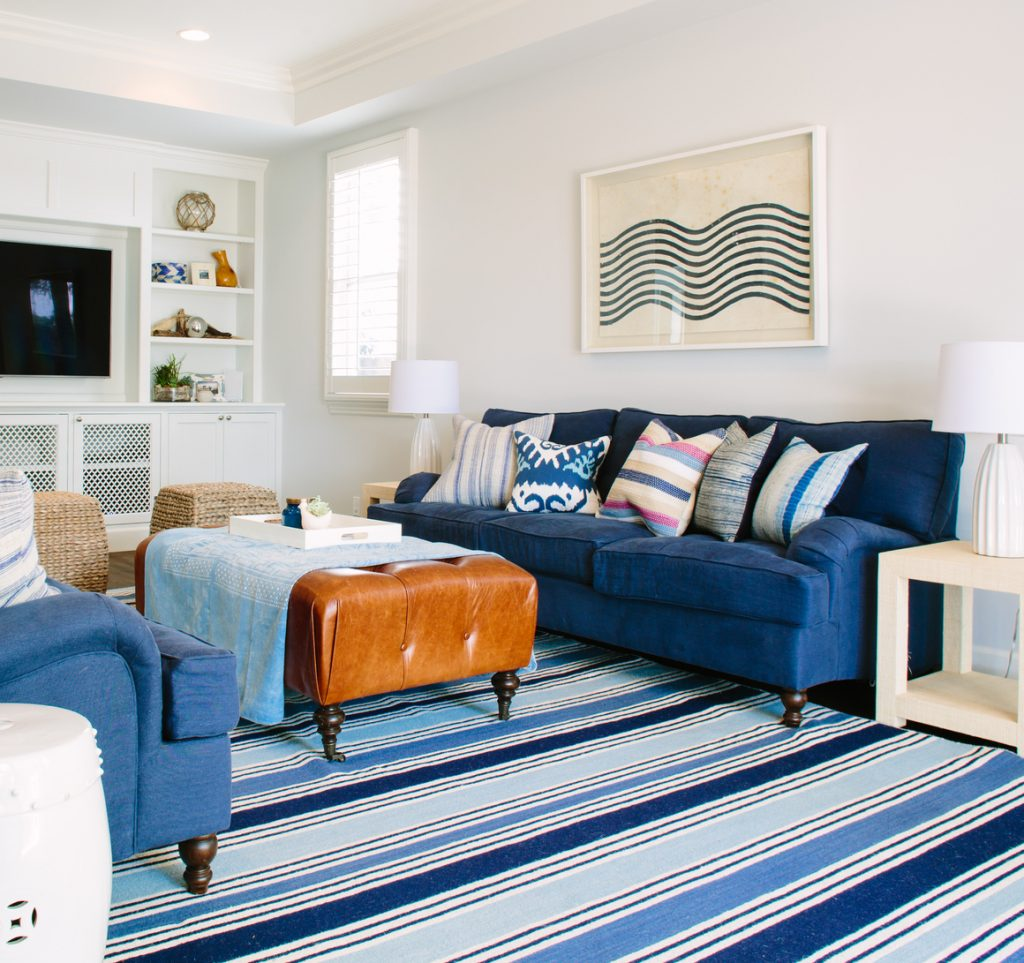 white walls blue sofa