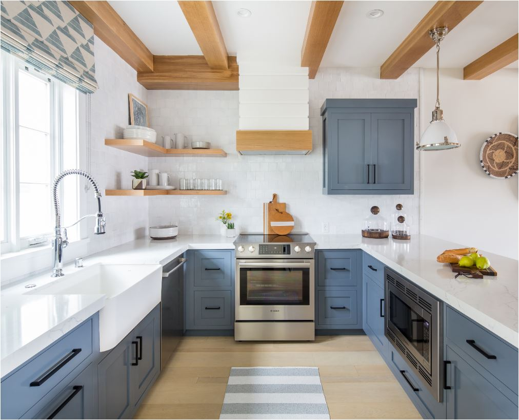 This is a beautiful mid tone slate blue in a kitchen designed by brooke wagner the natural wood tones look especially good with this blue hue