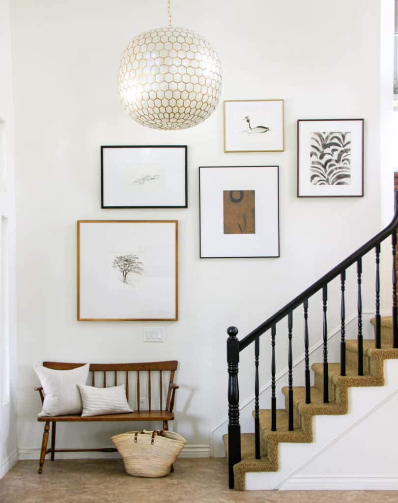 asymetric art arrangement staircase